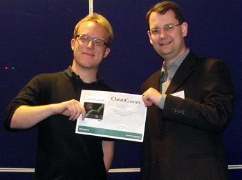 Rob Evans receiving his poster prize certificate from Iain Day