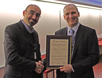 Jonathan Steed presents Jonathan Nitschke with the Cram Lehn Pedersen Prize