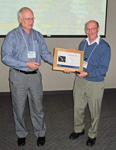 David Villeneuve presenting Stephen Leone with the 2011 Chem Soc Rev Lecture Award