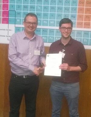 Phil Gale awards Marc Little his Chem Soc Rev poster prize