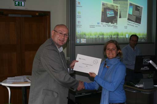 Myriam Bergmann being presented the Buchanan Memorial Prize by Prof. Rob Field
