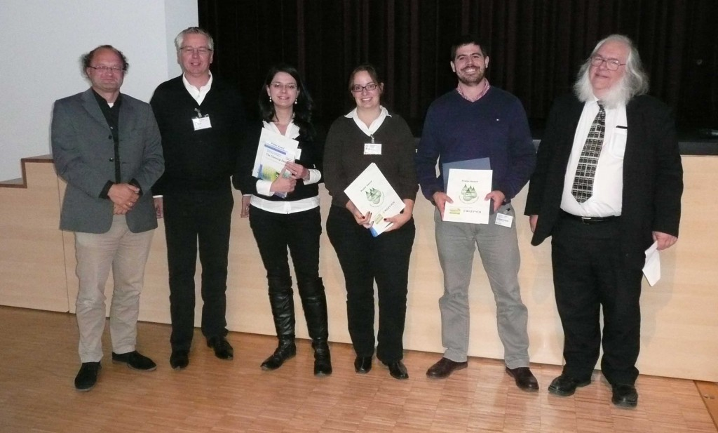 Poster prize winners from the 'Green Solvents for Synthesis' conference receiving their prizes from the organising committee
