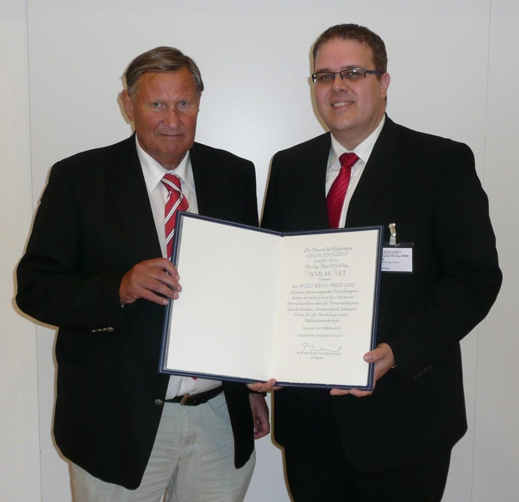 "Wilheim Keim presenting the inaugural ""Willi-Keim"" award to Nicolas Alt"