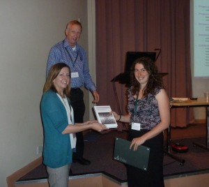 Charlotte Griffiths-Jones being presented with her CBID prize at Kinase 2014