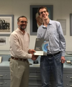 Poster prize winner Niall Igoie being presented with his award