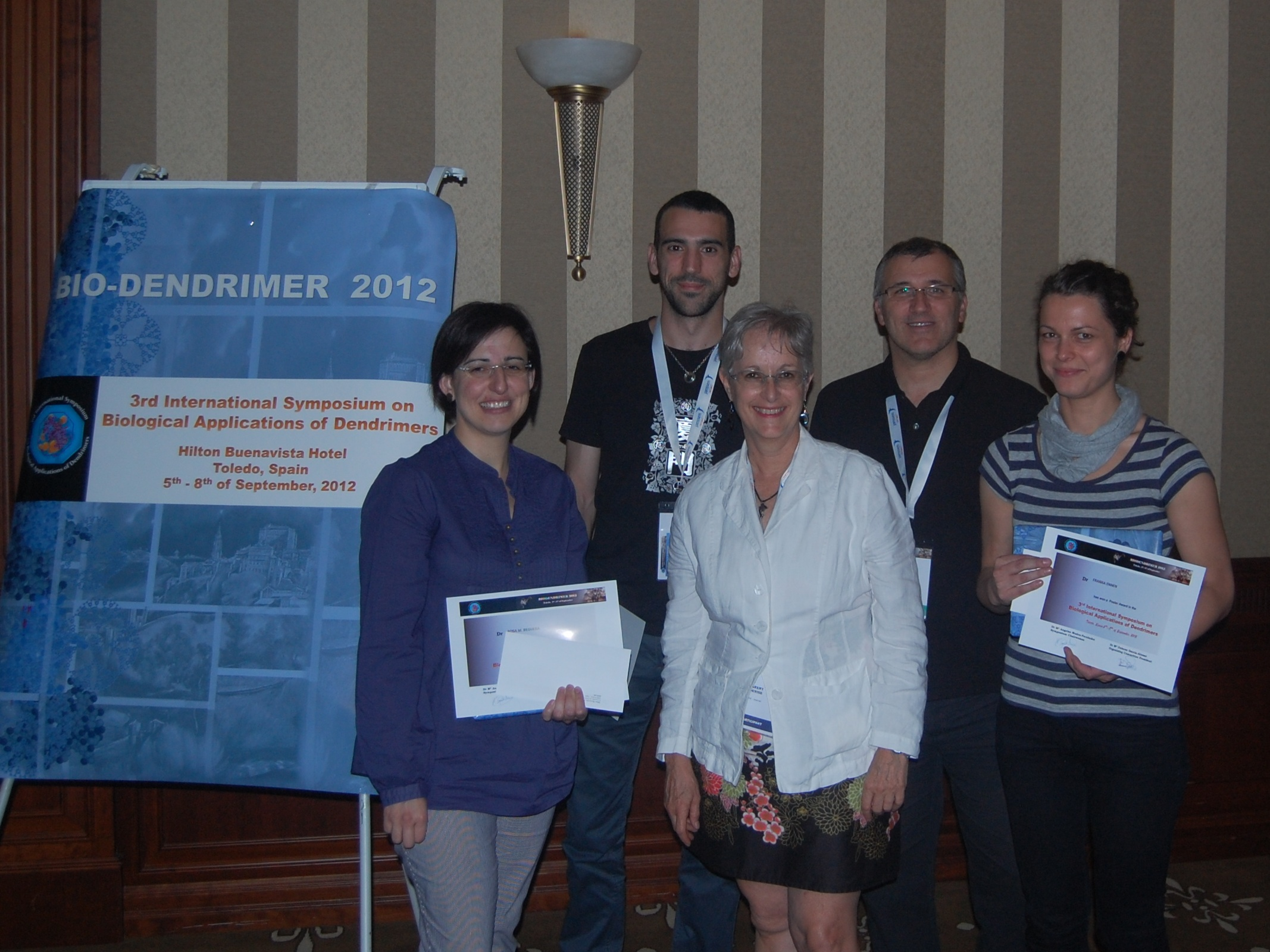 3 prize winners with editor and symposium organizer