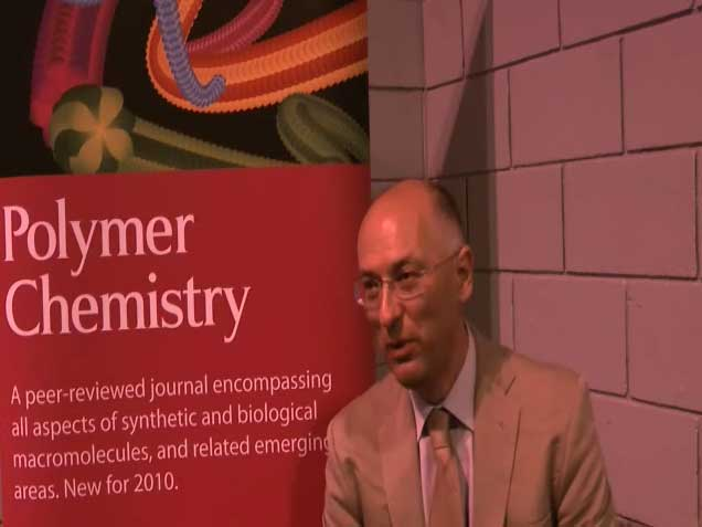 Photograph of Peter Budd as he talks to Polymer Chemistry