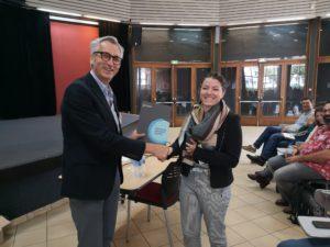 Margaux Roux, ENS Lyon receiving an RSC Advances poster prize from Professor David Parker