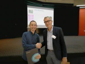 Salauat Kiraev receiving a RSC Advances poster prize from Professor David Paker at IMBG 2019