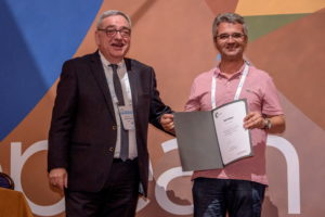 Dimitris Bikiaris receiving the Soft Matter certificate from Spiros Anastasiadis