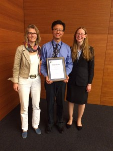 Peng Chen is presented with the 2014 Chem Soc Rev Emerging Investigator lectureship