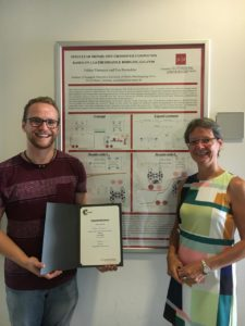 Fabian Fürmeyer in front of his poster with PhD supervisor Prof. Dr. Eva Rentschler.
