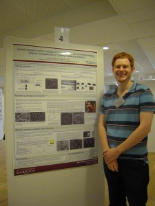 Nicholas Ballard in front of his winning poster