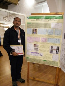 Sharad Pasale in front on his poster