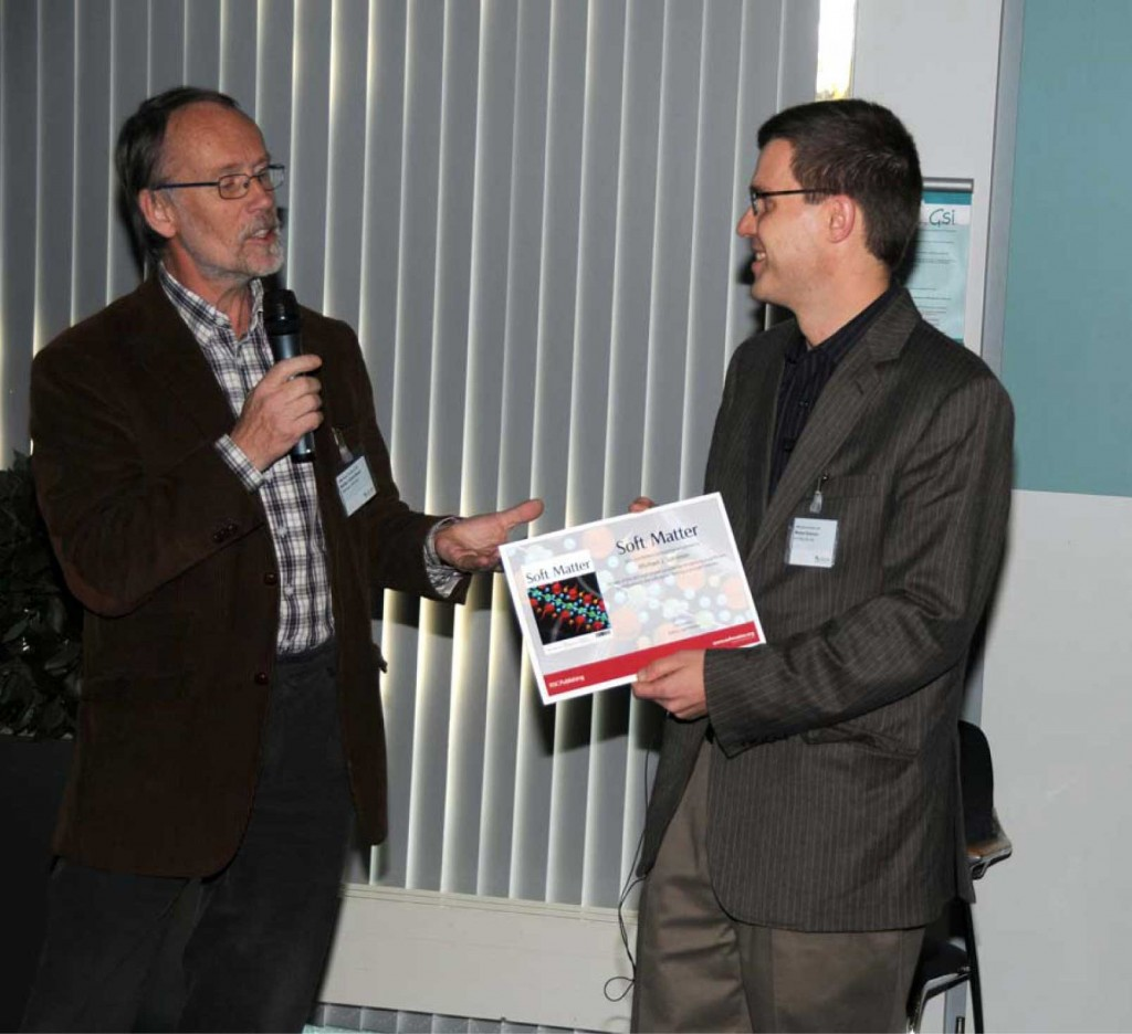 Michael J. Solomon receives the award from Martien Cohen Stuart