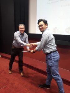 Soichiro Makino receiving his award